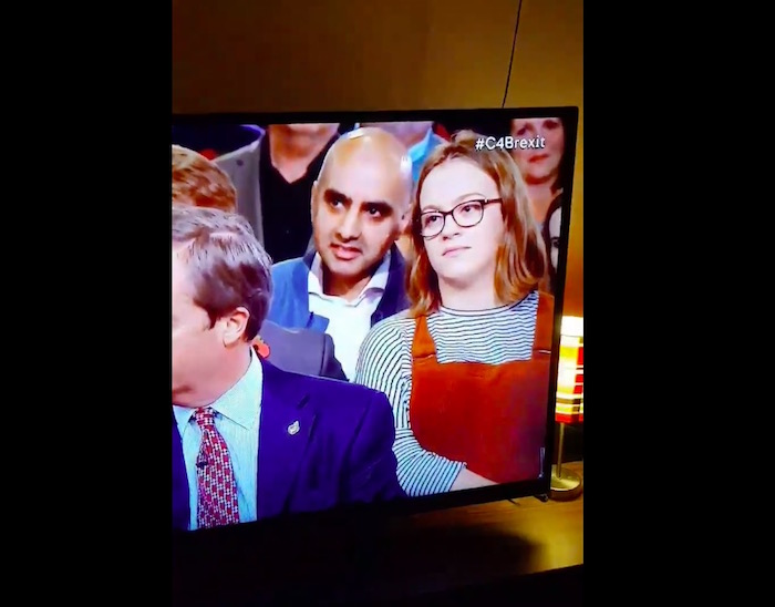 Watch this student's perfect eye-roll behind right-wing speaker during Brexit debate