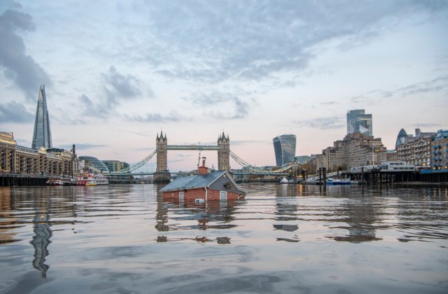 Extinction Rebellion floats a drowned house down the Thames