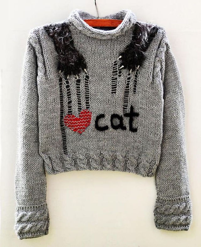 Intentionally distressed sweater looks like a cat's ripping it up