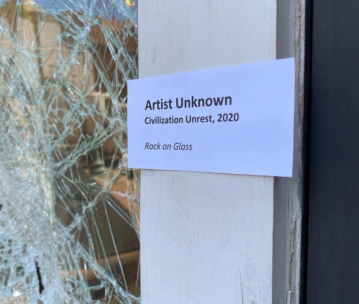 Smashed window in Memphis brilliantly labeled as artwork