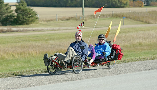 Brandonites John Simpson and Laurel McLaughlin pedal their recumbent tandem trike from Brandon to Virden along the Trans-Canada Highway on a sunny Thursday morning earlier this year.