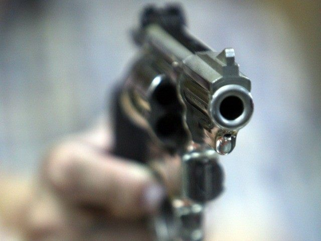 An employee at John Jovino Co. holds a revolver on Thursday, June 26, 2008 in New York. The U.S. Supreme Court ruled earlier in the day that Americans have a constitutional right to keep guns in their homes for self-defense - the justices' first major pronouncement on gun control in U.S. history.
