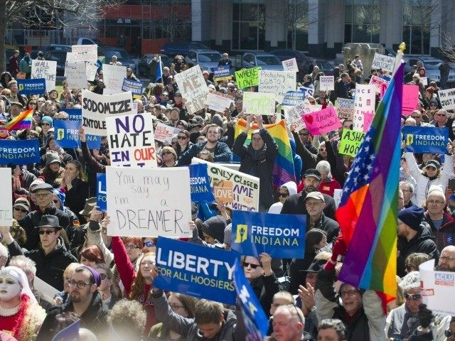 https://i2.wp.com/media.breitbart.com/media/2015/04/indiana-rfra-protest-flag-AP-640x480.jpg