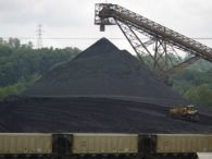A bulldozer works a coal mound at the Appalachian Electric Power coal-fired Big Sandy Power Plant June 3, 2014 in Cattletsburg, Kentucky. New regulations on carbon emissions proposed by the Obama administration have reportedly angered politicians on both sides of the aisle in energy-producing states such as Kentucky and West Virginia.