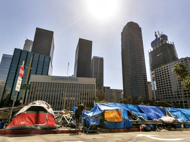 Homeless in L.A. AP Damian Dovarganes)