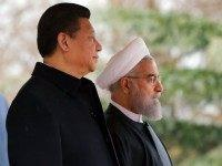 Iranian President Hassan Rouhani and Chinese President Xi Jinping (L) take part in a welcoming ceremony on January 23, 2016 in the capital Tehran.