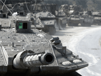 Israeli Merkava tanks and armour wait in a holding area near to the Israeli-Lebanon border as forces move deeper into Lebanon to root out Hezbollah militants carrying out rocket attacks on Israel on July 30, 2006, at a forward base near the northerly town Kiryat Shemona, Israel.