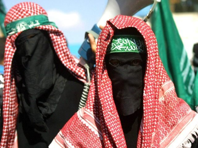 Masked members of the Islamic militant Hamas group march in the Jabalya refugee camp to protest against the U.S. position on Jerusalem October 4, 2002 in northern Gaza Strip.
