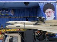 A military truck carrying Shalamcheh missiles drives past the presidential rostrum during the annual Army Day military parade on April 18, 2014 in Tehran. On the right is a portrait of Iran's supreme leader Ayatollah Ali Khamenei.