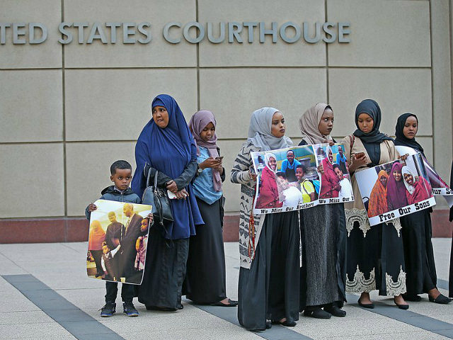 Supporters and family members of Somali men standing trial rally for a protest in front of the United States Courthouse, Monday, May 9, 2016 in Minneapolis. Six defendants have pleaded guilty to conspiring to provide material support to the Islamic State group. Three defendants have pleaded not guilty. Another man is at large, believed to be in Syria. (Elizabeth Flores/Star Tribune via AP) MANDATORY CREDIT