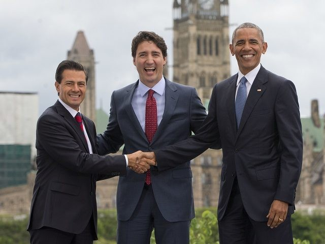 President Barack Obama, Canadian Prime Minister Justin Trudeau and Mexican President Enrique Pena Neito stand in front of Parliament Hill for a group photo during the North America Leaders' Summit at the National Gallery of Canada, Wednesday, June 29, 2016 in Ottawa, Canada. (AP Photo/Pablo Martinez Monsivais)