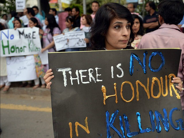 PAKISTANI HUMAN RIGHTS ACTIVISTS HOLD PLACARDS DURING A PROTEST IN ISLAMABAD ON MAY 29, 2014. AAMIR QURESHI/AFP/GETTY IMAGES