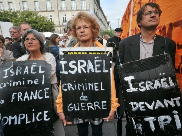 Three people hold anti-Israeli placards in the French western city of Nantes on May 31, 2010 during a demonstration against Israel's deadly raid on an aid flotilla bound for Gaza Strip.