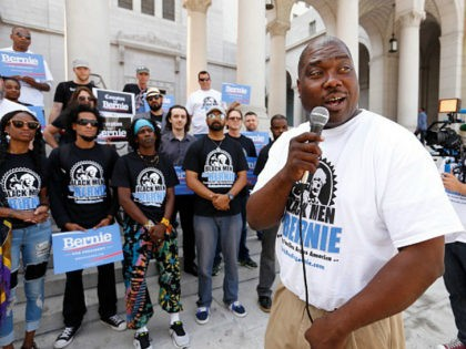 LOS ANGELES, CA - JUNE 03, 2016 - Bruce Carter founder of 'Black Men for Bernie' talks to supporters in front of Los Angeles City Hall Friday morning June 3, 2016. Traveling in a tour bus wrapped in this slogan the group is campaigning for the presidential candidate Bernie Sanders. (Photo by Al Seib/Los Angeles Times via Getty Images)