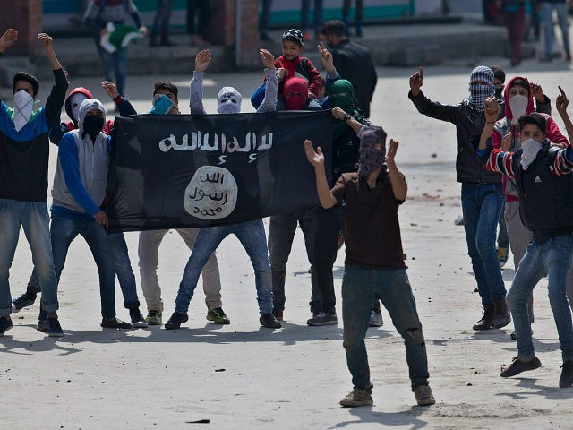 Kashmiri Muslim protesters hold a flag of Islamic State as they shout anti-India slogans during a protest in Srinagar, Indian controlled Kashmir, Friday, April 8, 2016. Police fired teargas and pellet guns to disperse Kashmiris who gathered after Friday afternoon prayers to protest against Indian control over a part of the disputed region of Kashmir. (AP Photo/Dar Yasin)