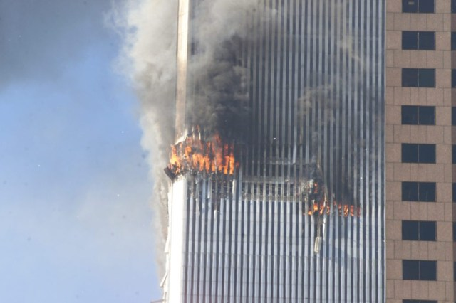 Debris fall from one of the burning twin towers of the World Trade Center after a hijacked plane crashed into the tower on September 11, 2001 in New York City.(AP Photo/Richard Drew)