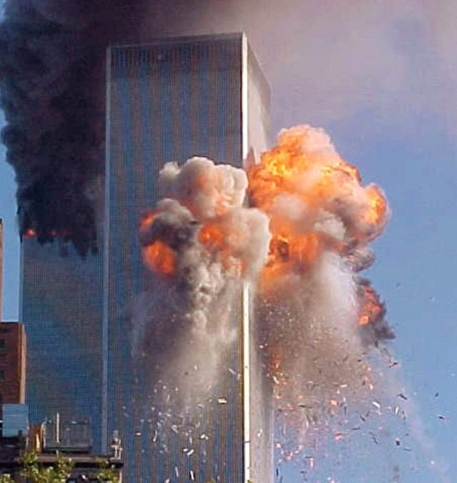 A fireball explodes from one of the World Trade Center towers after a jet airliner crashed into the building Tuesday, Sept. 11, 2001, in New York. (AP Photo/Carmen Taylor)