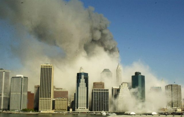 This is a view of the Manhattan skyline from Brooklyn, Tuesday, Sept. 11, 2001, after the World Trade Center towers collapsed following being struck by airplanes. (AP Photo/Kathy Willens)