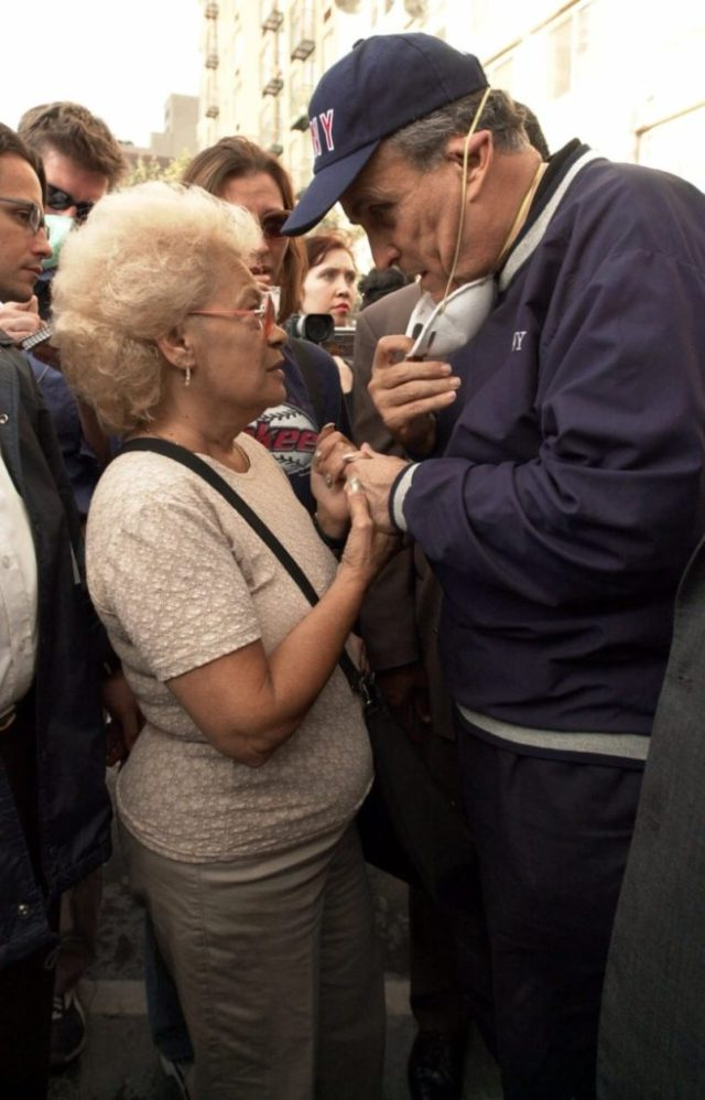 """New York City Mayor Rudolph Giuliani consoles Anita Deblase, of New York, whose son, James Deblase, 44, is missing, at the site of the World Trade Center disaster, Wednesday, Sept. 12, 2001. """"He's at the bottom of the rubble,"""" she said. James Deblase worked for Cantor Fitzgerald at the World Trade Center. (AP Photo/Robert F. Bukaty)"""