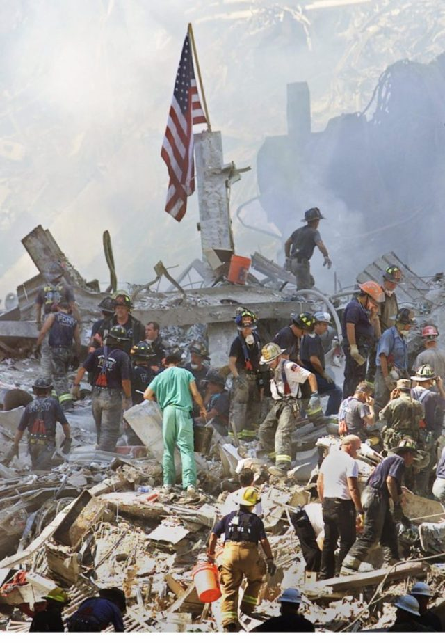 An American flag is posted in the rubble of the World Trade Center Thursday, Sept. 13, 2001, in New York. The search for survivors and the recovery of the victims continues since Tuesday's terrorist attack. (AP Photo/Beth A. Keiser)