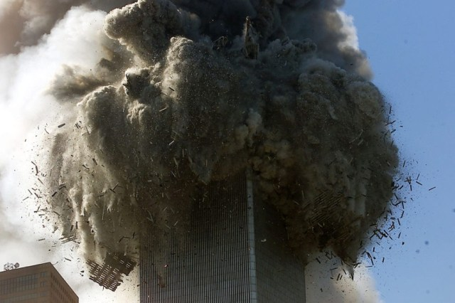 394263 01: (PUERTO RICO OUT) An explosion rocks one of the World Trade Center Towers crumbled down after a plane hit the building. (Photo by Jose Jimenez/Primera Hora/Getty Images)