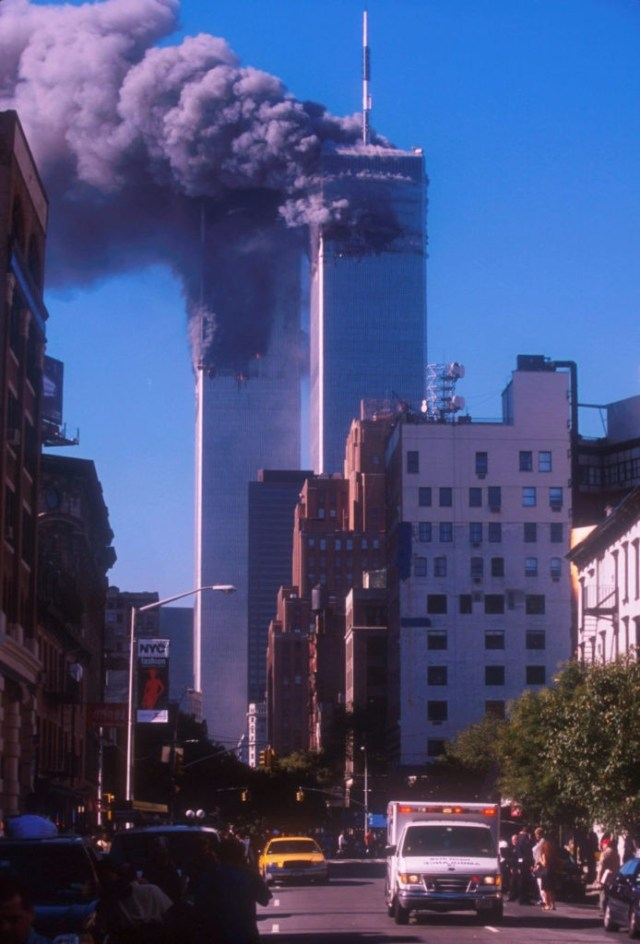 394273 03: Smoke billows from the World Trade Center's twin towers after they were struck by commerical airliners in a suspected terrorist attack September 11, 2001 in New York City. (Photo by Ezra Shaw/Getty Images)