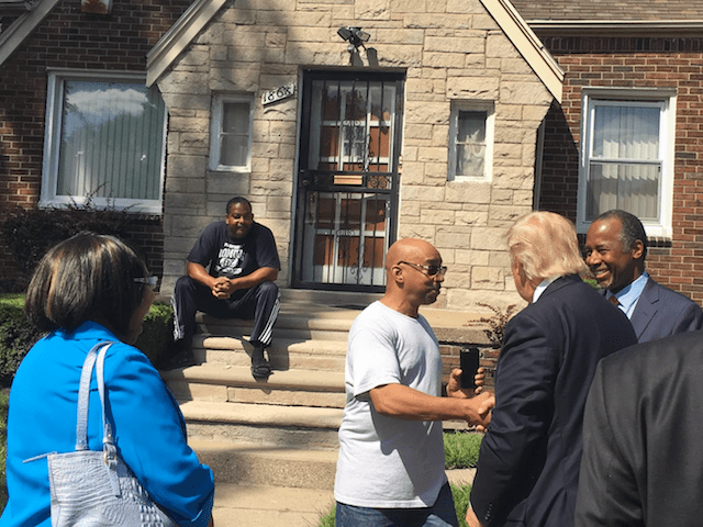Carson and Trump talk to the neighbors too as they stroll through the world renowned neurosurgeon's old stomping grounds.