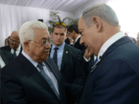 In this handout photo provided by the Israel Government Press Office (GPO), Israeli Prime Minister Benjamin Netanyahu shakes hands with Palestinian Authority President Mahmoud Abbas during the funeral of former Israeli leader Shimon Peres on September 30, 2016 in Jerusalem, Israel. World leaders and dignitaries from 70 countries attended the state funeral of Israel's ninth president, Shimon Peres, in Jerusalem on Friday, after thousands of Israelis paid their last respects to the elder statesman who died on Wednesday. (Photo by Amos Ben Gershom/GPO via Getty Images)
