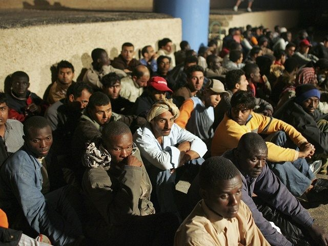 LAMPEDUSA, ITALY - JUNE 13: Illegal immigrants wait to be sent to a temporary holding centre for foreign nationals on June 13, 2005 in Lampedusa, Italy.  Lampedusa Island, in the Mediterranean Sea between Malta and Tunisia, is one of the main gateways for illegal immigration from Africa into Europe. According to Amnesty International, since last March, over 1,000 of people of various nationalities have landed by boat on the Sicilian island and have been detained on arrival and held at a temporary holding centre for foreign nationals before being deported. In March the United Nations High Commissioner for Refugees (UNHCR) requested access to the temporary holding centre but was denied. (Photo by Marco Di Lauro/Getty Images)