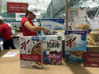 "This Oct. 16, 2016, file photo shows the Kellogg booth at an annual dietitians' conference, where company representatives explained the health benefits of their products, in Boston. On its website, amid news of Pop-Tarts and Frosted Flakes, Kellogg touted a distinguished-sounding ""breakfast council"" of ""independent experts"" dedicated to guiding its nutritional efforts. Nowhere did it say that Kellogg paid the council members and spoon-fed them talking points about the benefits of cereal and breakfast, according to a copy of a contract and email exchanges obtained by The Associated Press. (AP Photo/Candice Choi, File)"