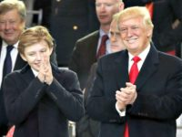Copyright 2017 The Associated Press. All rights reserved. This material may not be published, broadcast, rewritten or redistributed without permission. Mandatory Credit: Photo by Pablo Martinez Monsivais/AP/REX/Shutterstock (7945039cq) President Donald Trump, right, smiles with his son Barron as they view the 58th Presidential Inauguration parade for President Donald Trump in Washington Trump Inauguration, Washington, USA - 20 Jan 2017