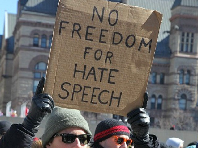 Pro-Muslim protestor carrying a sign saying 'No Freedom for Hate Speech' as opposing groups of protesters clashed over the M-103 motion to fight Islamophobia during pro-Muslim and anti-Muslim demonstrations in downtown Toronto, Ontario, Canada, on March 04, 2017. Canadians across the country staged similar protests against Islam, Muslims, Sharia Law and M-103. These protests were met by counter protests by those supporting Muslims and in favour of M-103. M-103 is a private members motion put forth by Liberal MP Iqra Khalid that asks the government to 'recognize the need to quell the increasing public climate of hate and fear' and condemn Islamophobia, as well as all other kinds of 'systemic racism and religious discrimination.' (Photo by Creative Touch Imaging Ltd./NurPhoto via Getty Images)