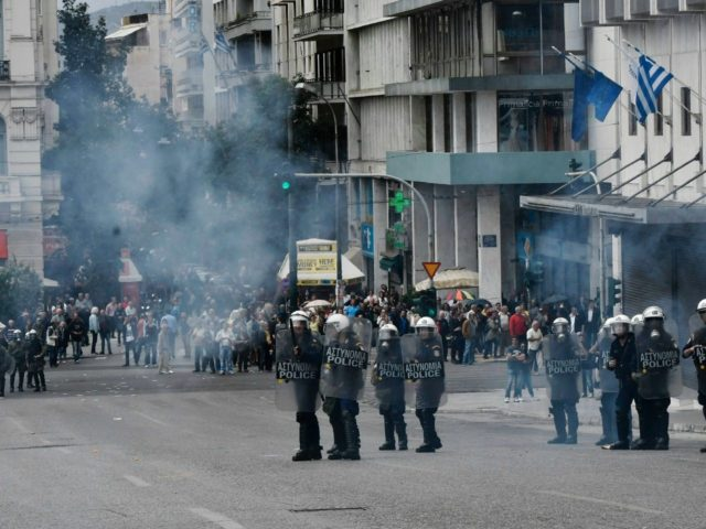 Police and anti - austerity protestors clash in Athens