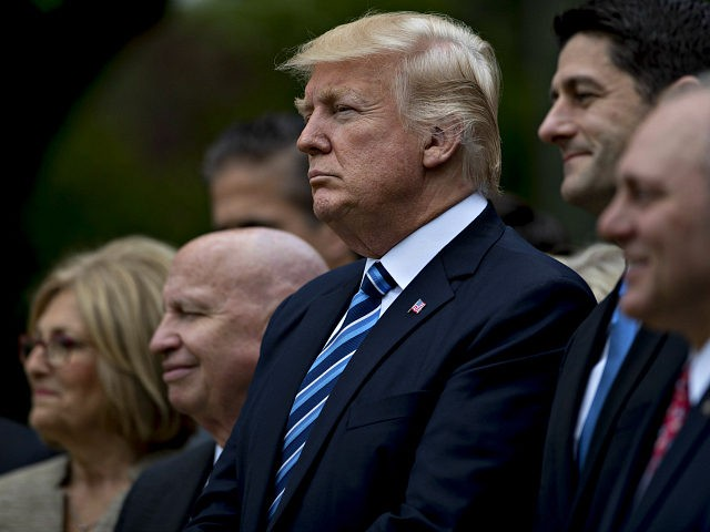 U.S. President Donald Trump, center, listens during a press conference in the Rose Garden of the White House in Washington, D.C., U.S., on Thursday, May 4, 2017. House Republicans mustered just enough votes to pass their health-care bill Thursday, salvaging what at times appeared to be a doomed mission to repeal and partially replace Obamacare under intense pressure from Trump to produce legislative accomplishments. Photographer: Andrew Harrer/Bloomberg via Getty Images