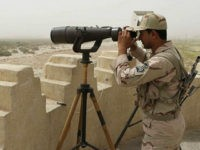 An Iranian border guard looks through a pair of binoculars to monitor a border area for drug trafficking activities on July 19, 2011, in Milak, southeastern Iran. The region borders both Aghanistan and Pakistan, and sits on a major trafficking route. The UN office on drugs and crime (UNODC) today praised Iran's anti-narcotics effort, urging other countries to follow its example, as its chief travelled to Tehran for a three-day visit. UNODC director Yury Fedotov also praised the cooperation between Afghanistan, Iran and Pakistan as part of a 'Triangular Initiative,' which has led to the seizure of several tons of drugs in joint operations. Some 89 percent of global opium seizures and 41 percent of heroin and morphine seizures occur in Iran, according to the UNODC. AFP PHOTO/ATTA KENARE (Photo credit should read ATTA KENARE/AFP/Getty Images)