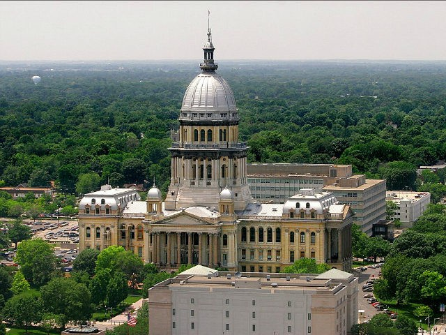 The Illinois State Capitol in Springfield, Ill., shown Wednesday, June 21, 2006, measures 361 feet to the top of its familiar dome. The neck-bending skyscrapers that pack Chicago's fabled skyline are little more than scaled-down miniatures in downstate cities, where even the tallest buildings are at least three times shorter than the Sears Tower and John Hancock Center. (AP Photo/Seth Perlman)