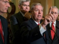 Sen. Lindsey Graham, R-S.C., joined by, from left, Sen. John Barrasso, R-Wyo., Sen. Bill Cassidy, R-La., and Senate Majority Leader Mitch McConnell, R-Ky., speaks to reporters as they faced assured defeat on the Graham-Cassidy bill, the GOP's latest attempt to repeal the Obama health care law, at the Capitol in Washington, Tuesday, Sept. 26, 2017. The decision marked the latest defeat on the issue for President Donald Trump and Senate Majority Leader Mitch McConnell in the Republican-controlled Congress. (AP Photo/J. Scott Applewhite)
