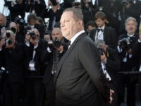 US producer Harvey Weinstein poses on May 24, 2013 as he arrives for the screening of the film 'The Immigrant' presented in Competition at the 66th edition of the Cannes Film Festival in Cannes. Cannes, one of the world's top film festivals, opened on May 15 and will climax on May 26 with awards selected by a jury headed this year by Hollywood legend Steven Spielberg. AFP PHOTO / ANNE-CHRISTINE POUJOULAT (Photo credit should read ANNE-CHRISTINE POUJOULAT/AFP/Getty Images)