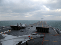 This photo taken on December 23, 2016 shows Chinese J-15 fighter jets being launched from the deck of the Liaoning aircraft carrier during military drills in the Yellow Sea, off China's east coast. Taiwan's defence minister warned on December 27 that enemy threats were growing daily after China's aircraft carrier and a flotilla of other warships passed south of the island in an exercise as tensions rise. / AFP / STR / China OUT (Photo credit should read STR/AFP/Getty Images)