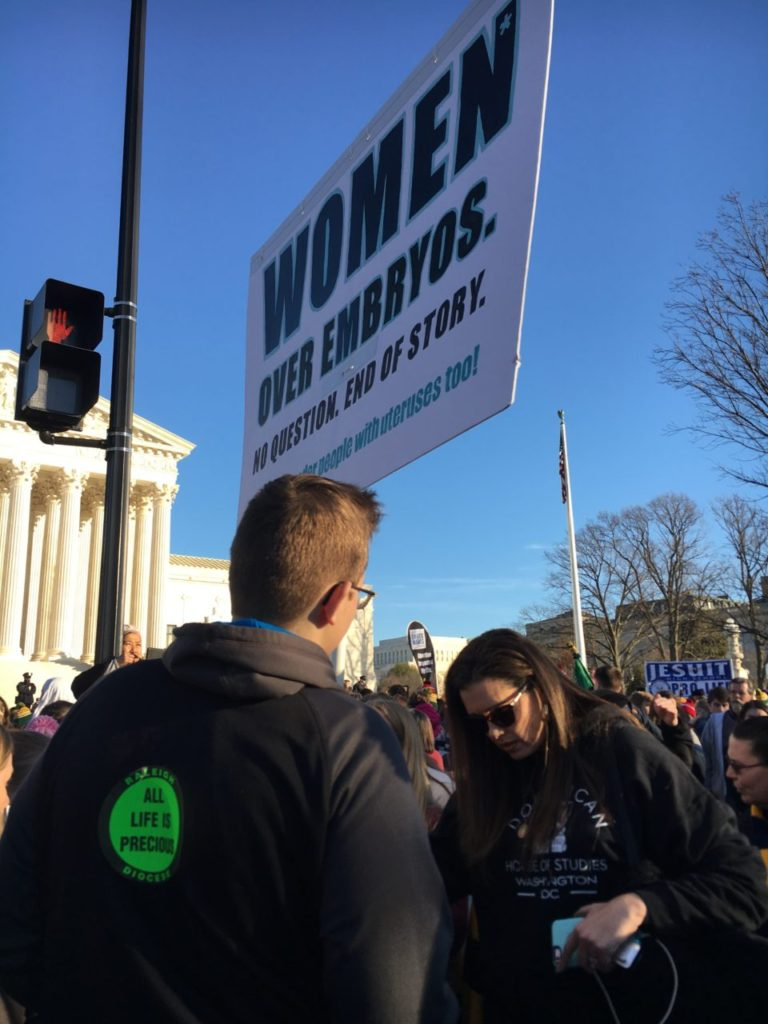 At the March for Life on January 19, 2018, a woman prays for someone.