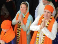 Canadian Prime Minister Justin Trudeau (R) along with his wife Sophie Gregoire (L) pay their respects at the SSikh Golden Temple in Amritsar on February 21, 2018. Trudeau and his family are on a week-long official trip to India. / AFP PHOTO / NARINDER NANU (Photo credit should read NARINDER NANU/AFP/Getty Images)