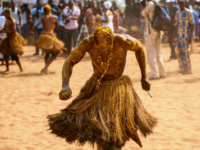 A Voodoo devotee in a trance performs at the annual Voodoo Festival on January 10, 2017 in Ouidah. Officially declared a religion in Benin in 1996, Voodoo and the Voodoo festival attracts thousands of devotees and tourists for a day filled with ritual dances and gin drinking. Benins voodoo festival is held every year and is the West African countrys most vibrant and colourful event. / AFP / STEFAN HEUNIS (Photo credit should read STEFAN HEUNIS/AFP/Getty Images)