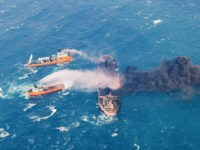 FILE - In this Wednesday, Jan. 10, 2018, photo provided by China's Ministry of Transport, firefighting boats work to put on a blaze on the oil tanker Sanchi in the East China Sea off the eastern coast of China. A Chinese official said Friday, Jan. 19, 2018, that the explosion and sinking of an Iranian oil tanker in the East China Sea was without precedent, creating enormous difficulties for rescue and recovery efforts. (Ministry of Transport via AP, File)
