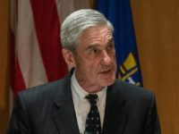 Special Counsel Robert Mueller, pictured in this August 8, 2013 file photo, charged 13 Russians for an alleged conspiracy to defraud the United States