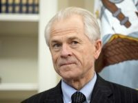 FILE - In this March 31, 2017, file photo, National Trade Council adviser Peter Navarro waits for President Donald Trump for an event in the Oval Office at the White House. Navarro signed on with the Trump campaign as a trade adviser, only to see his contrarian views marginalized when he arrived at the White House. Now Navarro and his protectionist trade policies are on the rise as his chief ideological rival, Gary Cohn, heads for the exit. (AP Photo/Andrew Harnik, File)