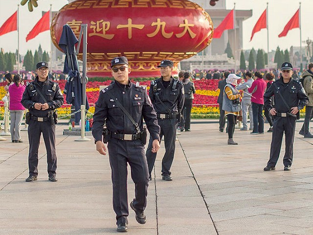 Chinese police patrol in Tiananmen square during the Communist Party's 19th Congress in Beijing on October 22, 2017. / AFP PHOTO / Nicolas ASFOURI (Photo credit should read NICOLAS ASFOURI/AFP/Getty Images)