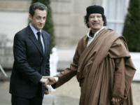 FILE - In this Dec. 10 2007 file photo, French President Nicolas Sarkozy, left, greets Libyan leader Col. Moammar Gadhafi upon his arrival at the Elysee Palace, in Paris. Former French President Nicolas Sarkozy was placed in custody on Tuesday March 20, 2018as part of an investigation that he received millions of euros in illegal financing from the regime of the late Libyan leader Moammar Gadhafi. (AP Photo/Francois Mori)