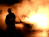 Firemen extinguish a burning car in Kista after youths rioted in few differant suburbs around Stockholm on May 21, 2013. Youths in the immigrant-heavy Stockholm suburb of Husby torched cars and threw rocks at police, in riots believed to be linked to the deadly police shooting of a local resident. AFP PHOTO/JONATHAN NACKSTRAND (Photo credit should read JONATHAN NACKSTRAND/AFP/Getty Images)