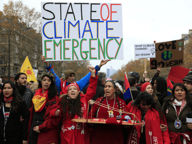 Climate activists demonstrate in Paris, Saturday, Dec.12, 2015 during the COP21, the United Nations Climate Change Conference. Several environmental and human rights groups are planning protests around Paris to call attention to populations threatened by man-made global warming and urge an end to human use of oil, gas and coal. (AP Photo/Thibault Camus)