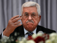 Palestinian President Mahmud Abbas gestures as he speaks during a Christmas lunch with members of the Christian Orthodox community on January 6, 2016 in the West Bank city of Bethlehem. Mahmud Abbas dismissed weeks of rumours the Palestinian Authority could collapse, saying he would 'never give up' on it. AFP PHOTO / THOMAS COEX / AFP / THOMAS COEX (Photo credit should read THOMAS COEX/AFP/Getty Images)